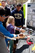 Kids Practice Using Prosthetic Arms At Atlanta Science Fair - stock photo