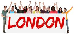 London group of young multi ethnic people holding banner Stock Photos
