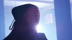 4K The face behind the mask of a Japanese kendo fighter engaged in combat Stock Footage