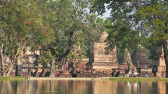 Tourists driving motorbike in Sukhothai Historical Park Stock Footage