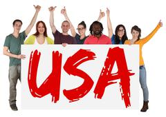 USA immigration group of young multi ethnic people holding banner - stock photo