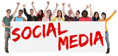 Social media networking happy group of young multi ethnic people holding bann Stock Photos