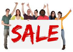 Group of young multi ethnic people holding banner sale while shopping Stock Photos