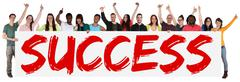 Success successful group of young multi ethnic people holding banner Stock Photos