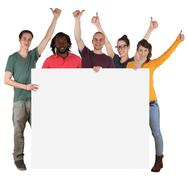 Young multi ethnic people holding empty banner with copyspace - stock photo