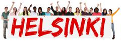 Helsinki group of young multi ethnic people holding banner - stock photo