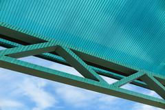 Arc polycarbonate canopy against a blue sky Stock Photos