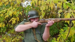 Wehrmacht soldier fires his rifle. Close-up. Stock Footage