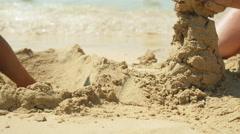 Building sand castle close-up. Stock Footage