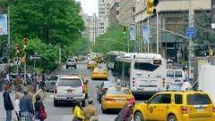 Urban Manhattan busy street traffic New York City NYC cars pedestrians day - stock footage
