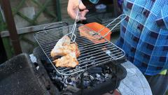 Stock Video Footage of Barbecue - woman placing chicken pieces on the grill