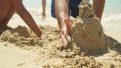 Building sand castle close-up. - stock footage