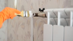 Paints a heating radiator in  apartment Stock Footage