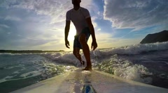 Surfing at dusk Stock Footage