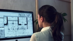 Woman working at home office architectural plans - stock footage