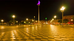 People walk on the Place Massena in Nice at night Stock Footage