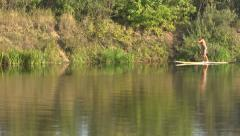 A man on the river, Paddle Board - stock footage