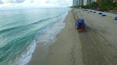 Beach tractor rake Stock Footage