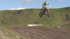 Motocross rider slow motion jump through the air Stock Footage
