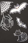 Halloween decorations cat, spider, bat and spiderweb Stock Illustration
