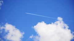 airplane contrail in the blue sky - stock footage