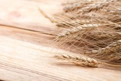 Wheat on wood Stock Photos