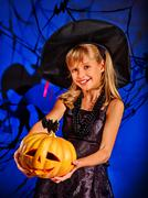 Witch child at Halloween party - stock photo