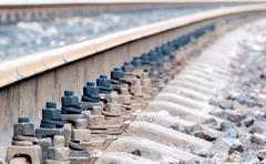 Closeup of rails and sleepers leaving afar Stock Photos