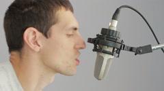 Man singing at studio microphone Stock Footage