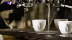 Barista makes two espresso in coffee bar Stock Footage