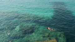 Snorkeler swimming. - stock footage