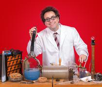 inventor at his desk with equipment - stock photo