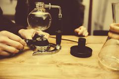 Stock Photo of Preparation of vacuum coffee
