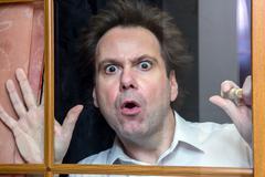 Curious man - stock photo