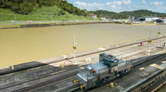 Panama Canal Locomotive Wide Guiding Ship Through Locks Stock Footage