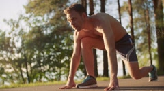 Portrait of man standing on start before running. Muscular man in black singlet Stock Footage