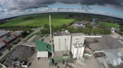 Aerial drone flying away from industry factory plant dark sky 4k Stock Footage