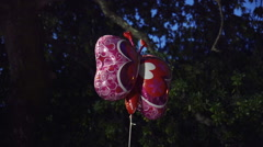 Helium balloon floating at dusk,kid's night party at home Stock Footage