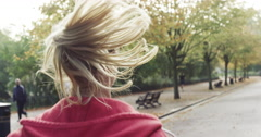 Woman running pony tail Close up behind shot Stock Footage