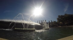 Fountain filmed from its edge with sunshine - stock footage