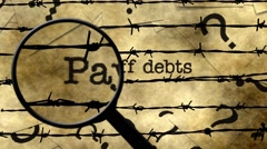 Magnifying glass on pay off debts - stock footage