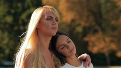 Mother and her daughter in an embrace Stock Footage