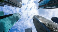 Cloud moving fast in opposite over Shanghai business building:4K time lapse. - stock footage