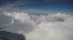 Passanger view of clouds and sky from plane Stock Footage