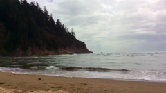 Oregon Coast beach cove with forested cliffs Stock Footage