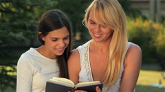 Reading a book on a bench park Stock Footage