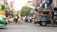 Tuk-tuk drivers rest wait for clients, Khao San road perspective Stock Footage