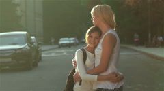 Standing in an embrace on the road Stock Footage