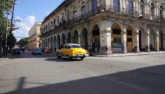 Two cuban vintage cars crossing the street in La Habana, Cuba Stock Footage