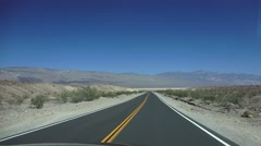 HIGHWAY, driving by desert mountains, Panamint Springs driving away Stock Footage